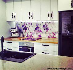Our Colourful Geometric Kitchen Splashback under lights. Wallpaper under glass…