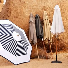 Made for the shade. Waterproof and UV-resistant, this tough woven-polyester canvas umbrella and its hardwood pole offer the perfect balance of understated style and shelter from summer rays.
