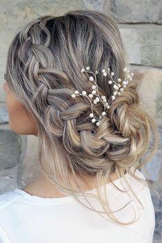 wedding hairstyle trends low messy updo with braid karina kotok via instagram