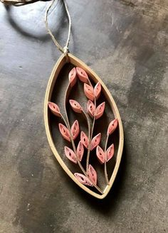 Erin Curet of Little Circles made the Leafy Vine Pendant from The Art of Quilling Paper Jewelry, proof that you don't need special jewelry findings to make a pretty piece! More ideas at the link.