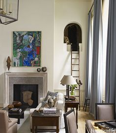 """Secret Room In a New York City apartment, the ladder leads to a secret room that designer Christopher Maya found, all sealed up, and turned into a """"fantasy room"""" for the children. """"I put lots of books inside it and cushioned seats to sit and read,"""" says Maya. """"But don't you remember how much fun it was to sort of hide and watch your parents' parties? I kind of like to imagine them doing that up there, too."""" Cool Kids Spaces - Kids Decorating Ideas - House Beautiful"""