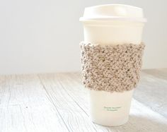 Double Seed Stitch Coffee Cozy | Give your coffee cup the royal treatment with this adorable knit cozy.