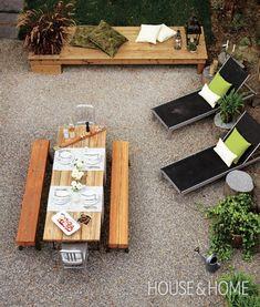 pea gravel patio. love the color scheme, tables + stumps