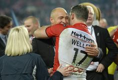 St Helens coach Nathan Brown and captain Paul Wellens embrace after winning the First Utility Super League Grand Final between St Helens and Wigan Warriors at Old Trafford on October 11, 2014 in Manchester, England.