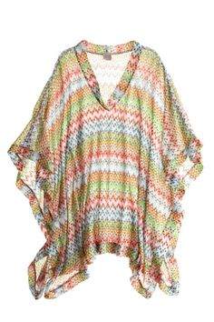 Short Kaftan. A vibrant beach cover-up that you can pair with shorts or slim-leg jeans.
