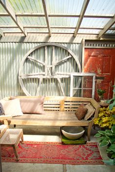 love this portland house- bell wheel from old british church tower, indonesian daybed & antique red door.