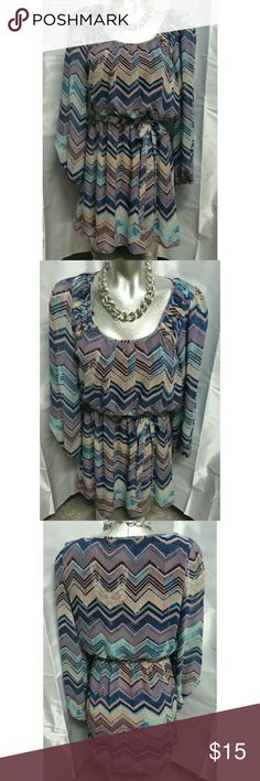 Ladies med. Long sleeve mid length dress Sheer outer layer flowy dress. Chevron design in purples and blues. Long sleeve, mid length. Medium. Worn and cleaned once. In like new condition. Speechless Dresses Long Sleeve