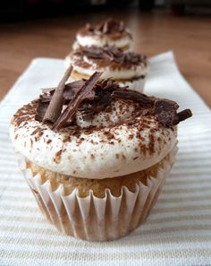 Tiramisu Cupcakes are so easy to make, starting with simple vanilla cupcakes. Cupcakes are brushed with mixture of coffee and Kahlua coffee liqueur. The cupcakes are topped with delicious frosting made by Martha Stewart's recipe and garnished with dark chocolate shavings. - bjl