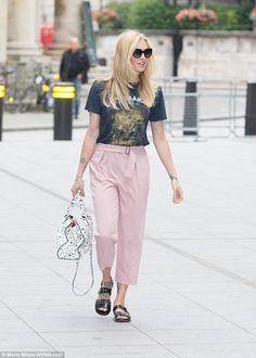 Chic: She paired pink trousers with a rock and roll T-shirt to soften the look...