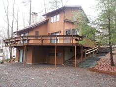 SOLD Welcome to the Lakeville Neighborhood! Contemporary home with seasonal views of Lake Wallenpaupack, 4BR/2BA, open floor plan with wood cathedral ceilings, stone hearth FP