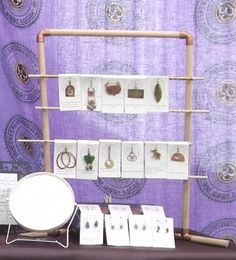 Use copper pipe fittings and wooden dowels to make displays. Friggin genius!