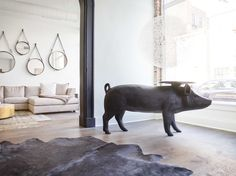 @moooi brought this swine to it's practical life, saying hello (edit: oink) to passer-bys at our showroom and holding our mail. #pigtable #statementpiece #pigs
