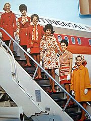 Continental Airlines flight attendant uniforms taken on airstair, English, June 1972.