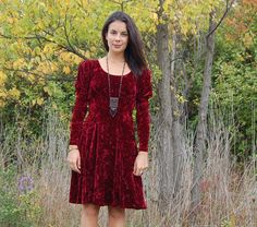 Crushed red velvet empire line dress with long puff sleeves dress