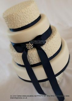 navy wedding cakes | Tier Ivory and Navy Blue Wedding Cake