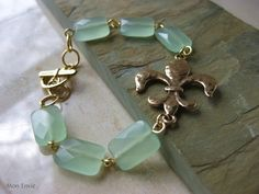 Seafoam Green Aventurine Faceted Rectangles, Gold FleurdeLis Focal, Wire Linked Gemstone Bracelet. $20.00, via Etsy.