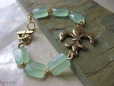 Seafoam Green Aventurine Faceted Rectangles, Gold FleurdeLis Focal, Wire Linked Gemstone Bracelet. $20.00, via Etsy.