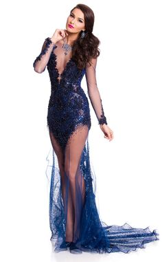 Miss Czech Republic from 2015 Miss Universe Contestants in Evening Gowns  Nikol Švantnerová sparkles in a zequin navy long-sleeved gown with sheer paneling at the neckline and over her legs.