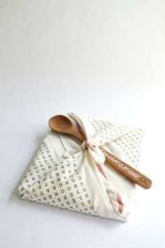 Cute and practical Kitchen tea gift wrapping idea using a Tea Towel and wooden spoon