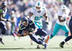 Seahawks coach Pete Carroll says Russell Wilson's ankle injury is 'nothing very serious'   -     Miami Dolphins defensive tackle Ndamukong Suh steps on Seattle Seahawks quarterback Russell Wilson's foot in the third quarter  as the Seattle Seahawks take on the Miami Dolphins at CenturyLink Field Sept. (Dean Rutz / The Seattle Times)