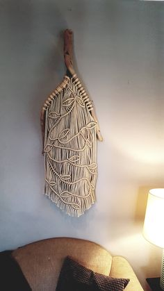 Unique and One of a Kind Pacific Coast driftwood with ivory vine and leaf macrame. Overall height is 56 and the width is 19 Just the driftwood is 33 x 19 Be sure to check out HemisphereCA for more of my art. Thank you