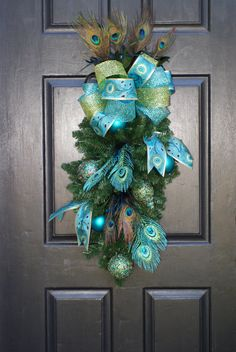 Sassy Kassy would love this! Peacock Christmas, Christmas Swags, Holiday Wreaths, Christmas Crafts, Christmas Decorations, Christmas Stuff, Merry Christmas, Peacock Decor, Peacock Art