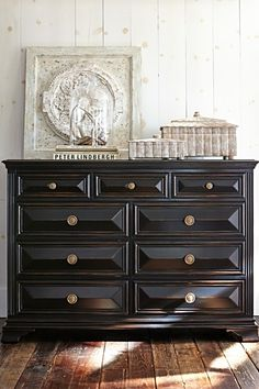 "Artisanal prism handcarving distinguishes the Ravenna Tall Dresser – a true designer showpiece. The prism pattern on the drawer front and radiating ""chip"" design on the doors evoke the deeply carved style of 17th century Flemish furnishings."