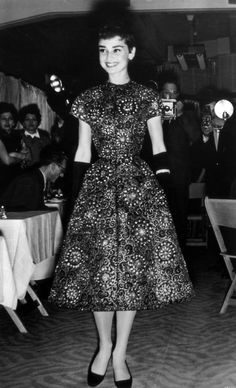 Audrey Hepburn modeling a new collection at an Amsterdam fashion show, 1954.