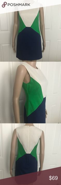 "Trina Turk color block cotton sheath dress 0 Rare Trina Turk figure flattering, color block white green and navy sheath fitted, fully lined dress. Size 0. Hidden back zipper.  Beautiful textured fabric.  Excellent used condition. Please note that the lining might need to be taken in a quarter of an inch if it shows around the hem.  Shell made of 98% cotton and 2% spandex. Lining is 100% polyester.  Approximate measurements laying flat:  armpit to armpit 16"", waist 14"", hips 17.5"", shoulder…"