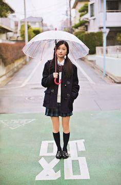 High schooler under the rain