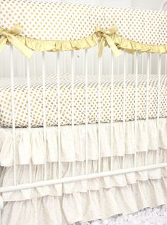 Add some aqua accents in the nursery with this bedding and it would make a perfect gold and aqua nursery!