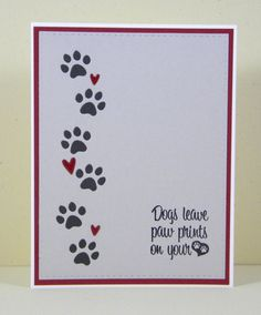 Dogs do leave paw prints on our hearts. Share this card with someone you know who has recently lost their pet. Knowing you care may help ease their pain.  Card front features a die cut stitched rectangle of either light grey or kraft card stock in which pawprints have been inlaid (dark grey pawprints on the light grey card or brown on the kraft card). That is 30 tiny pieces hand inlaid on each card. The sentiment has been stamped in black and tiny red glossy hearts have been added. This is…