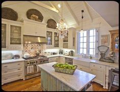 I love this kitchen...especially the color on the island...