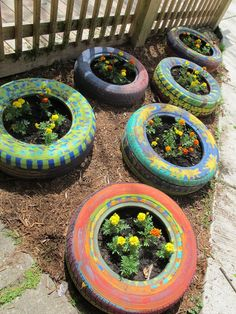 Tires repurposed into flower beds by the kids of ACE2! Check out more photos on the blog http://heidelbergkids.tumblr.com