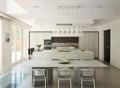 A mix of bar seating and formal dining seating allows guests the opportunity to mingle before and after dinner - something to consider if you are embarking on designing your dream kitchen for entertaining Dining Area, Kitchen Dining, Dining Table, Open Plan Kitchen Diner, Bar Seating, Home Kitchens, White Pendants, Central Island, Kitchen Extensions