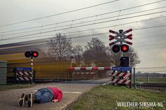 """Waiting for the red light"", selfie project 52, week 10 Shot in two separate images to avoid disturbance for the train driver. #self #facedown #railroadcrossing #planking"