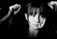 Violet Baudelaire tying her hair in a ribbon. (gif)