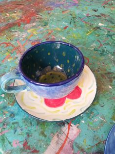 a teacup painted at Faux Arts in Marlborough, in a ceramic drop in