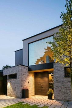 Love the stone veneer, matching long pavers and big window.