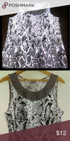 White tunic length top with snakeskin print White tunic length top with snakeskin print, and silver studs and threads at collar. Laura Scott Tops Tunics