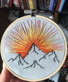 Hand embroidered mountain sunset with a hoop.Russian artist Vera Shimunia creates colorful embroidery designs that look like pieces of landscape art. Using various embroidery stitches, each embroideryBeginner Embroidery- Materials and Tips to Get you Hand Embroidery Stitches, Learn Embroidery, Embroidery Hoop Art, Hand Embroidery Designs, Cross Stitch Embroidery, Beginning Embroidery, Indian Embroidery, Embroidery Ideas, Little Presents