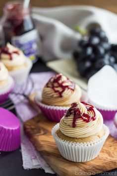 pb&j cupcakes; the best ever (must try) moist and fluffy peanut butter cupcakes are filled with grape jam, and topped with swirls of peanut butter swiss meringue buttercream frosting