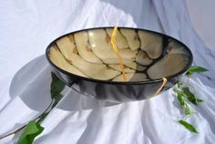 """The term """"kintsugi"""" or """"kintsukuroi"""" means 'golden joinery' in Japanese and refers to the art of fixing broken ceramics with a lacquer resin made to look like solid gold. Description from kintsugigifts.com. I searched for this on bing.com/images"""