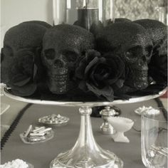 Skull centerpiece, easy DIY but would use deep red roses and some scatter pillar candles