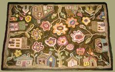 hooked rug ...I've seen this Karen Kahle rug done in all kinds of colors...some bright & wild...some soft & vintage...nice!