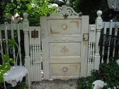 "pinner said ""I made this entry gate from an old door and embellished it with some stain in design, some added wooden architectural pieces, and a vintage ladder hook, which you can see as you leave the garden"" https://www.facebook.com/pages/EmBellish/208986802497524"
