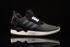 adidas comes in strong with the all-black adidas ZX 8000 Boost, its newest silhouette. The sneaker is a hybrid of sortswith its adidas ZX8000 components crossed withwhat looks like a slimmer version...
