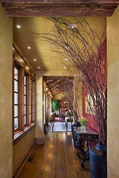 Locati Interiors.  Rustic timbers. Wood floor. Wood casing on windows. Wood baseboard.