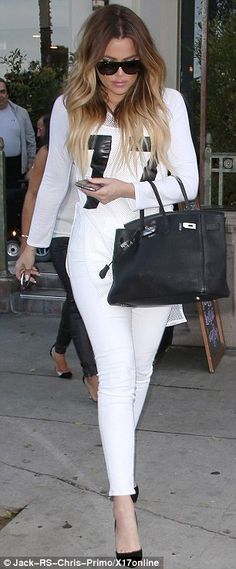 Ombre locks: Khloe Kardashian had her two-tone hair down and cascading upon her shoulders