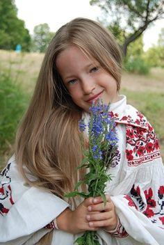 A smiling blonde girl is wearing a blouse with the Russian traditional embroidery. #cute #kids #Russian #folk. Russian beauty. Russian girls.